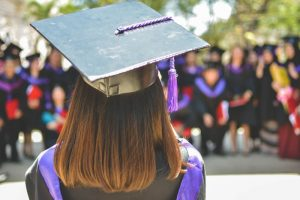 woman wearing academic cap and dress selective focus photography